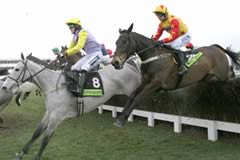 Iris's Gift (AP McCoy) taking one of the Gold Cup fences in front of Sir Rembrandt